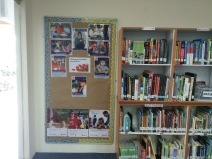Display board at entrance and shelf with: Reference books, Teacher Books & World languages stuck at bottom